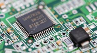 3336297-macro-foto-de-componentes-electr-nicos-en-circuitos-el-ctricos-foto-de-archivo.jpg
